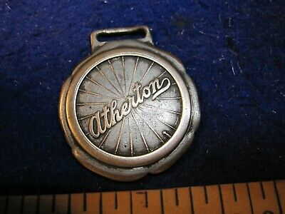 vintage advertising pocket watch