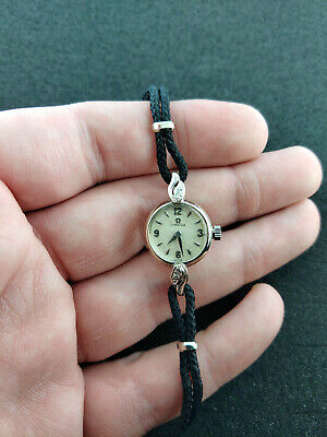 VINTAGE LADIES OMEGA SOLD WHITE GOLD WRIST WATCH WITH DIAMOND EDGE SETTING