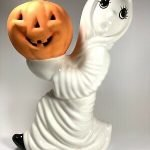 ceramic ghost holding pumpkin